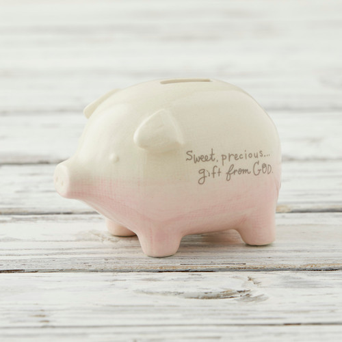 Small cream/light pink piggy bank with 'sweet precious gift from God' in brown - on white wooden surface