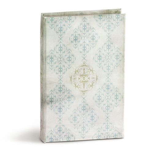 White book standing up with light blue designs on it