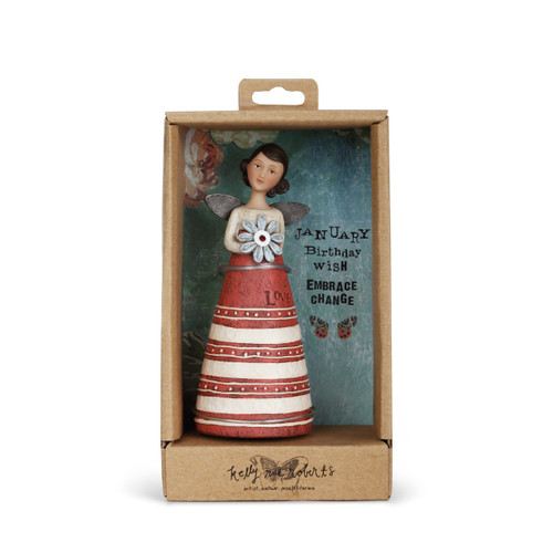 Angel figurine with brown hair and wings wears a dress with a cream top and a red&white striped skirt. Brown engraved lettering on skirt. Angel holds a pale blue flower. Angel is in brown gift packaging.