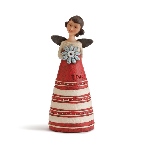 Angel figurine with brown hair and wings wears a dress with a cream top and a red&white striped skirt. Brown engraved lettering on skirt. Angel holds a pale blue flower