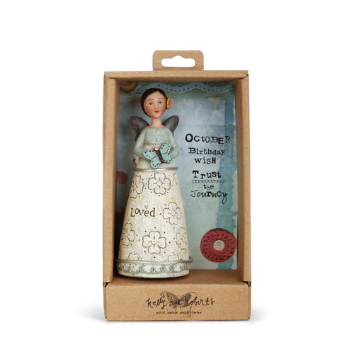Angel figurine with brown hair and wings wears a dress with a light blue top and cream skirt. LIght blue decal around base of skirt. Angel has an orange flower in her hair and holds a blue butterfly. Angel is in brown gift packaging