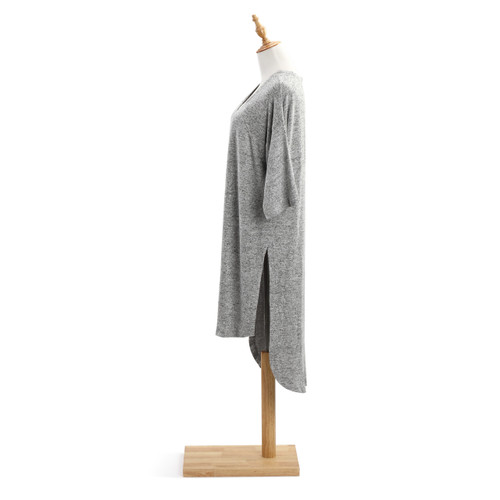 Side view of light grey shawl on wooden mannequin stand