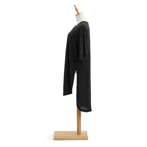Side view of light wooden mannequin stand with black shawl on it