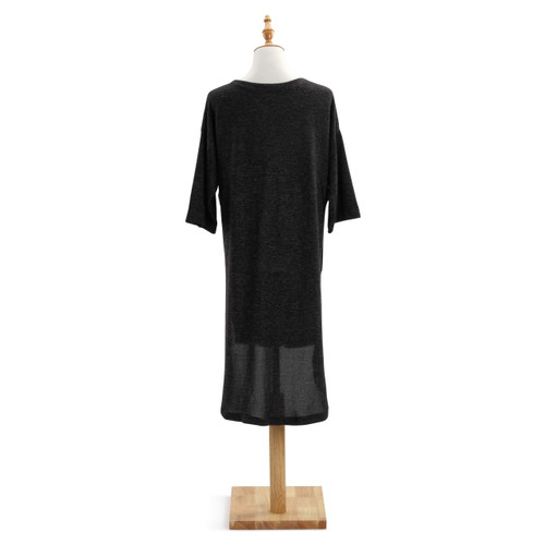 Back view of black shawl on white wooden mannequin stand