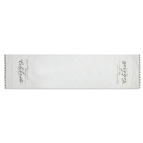 Side view of white table runner with black quotes on top and bottom