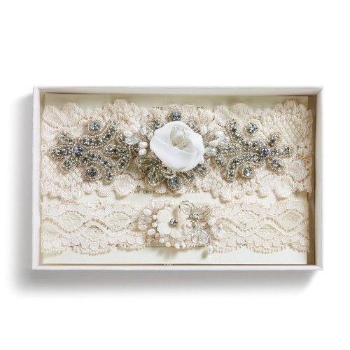Cream embellished white lace headband inside white box