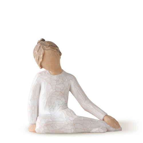 Faceless girl figurine sitting with hands on her legs