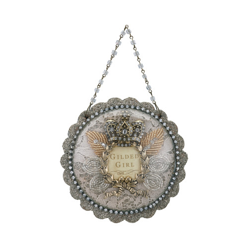 Hanging round silver ornament with 'gilded girl' in the center