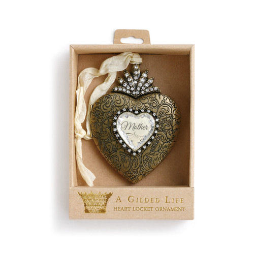 Light brown box with 'a gilded life heart locket ornament' on it and inside is gold heart figurine with 'mother' in the center