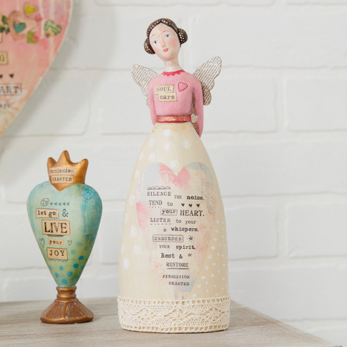 figure of angel and heart standing up with phrases on them