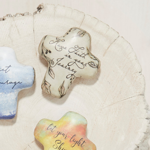 cross shaped trinkets with Have Faith in your Journey written in script font