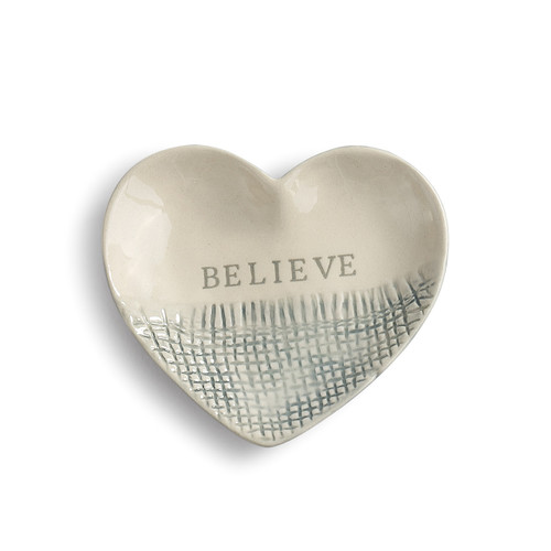 Cream heart plate with 'believe' on it in grey