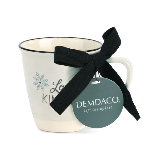 white mug with ribbon tied to product label card
