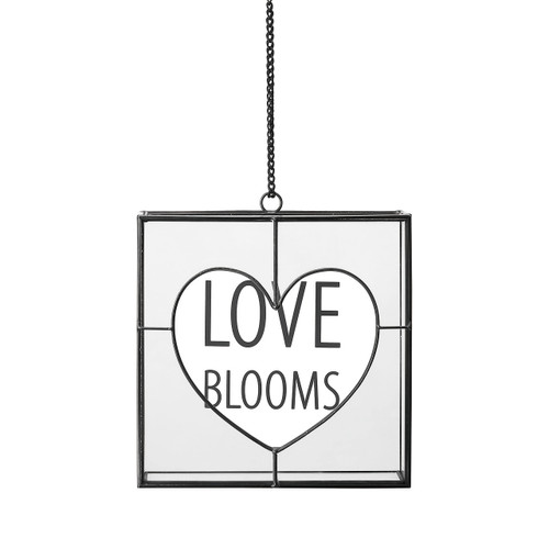 wire and glass hanging box reading Love Blooms