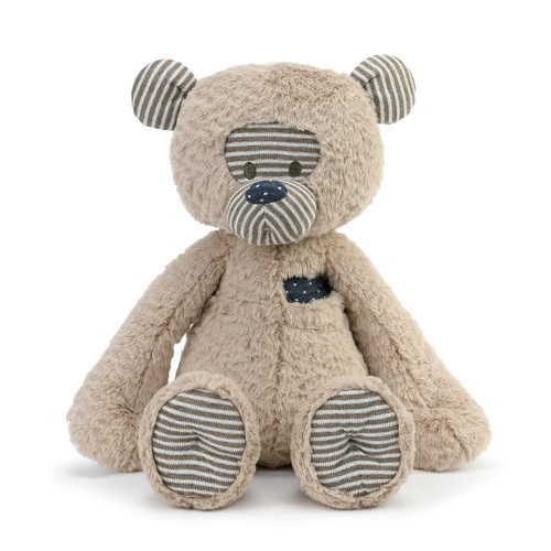 tan stuffed bear with striped nose and ears