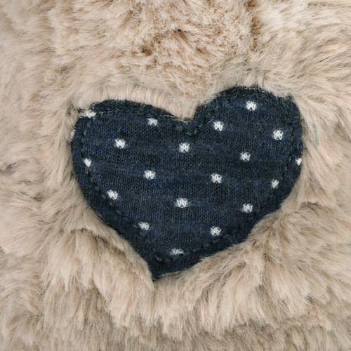 navy blue heart decal with white polka dots stitched onto fluffy tan stuffed animal