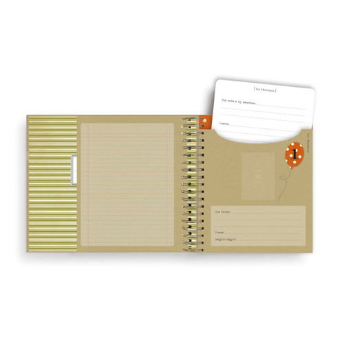 tan open journal with pockets inside