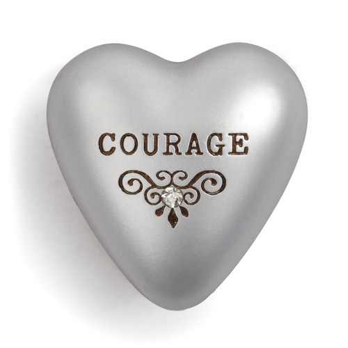 Silver heart figurine with courage brown letters above embellished design
