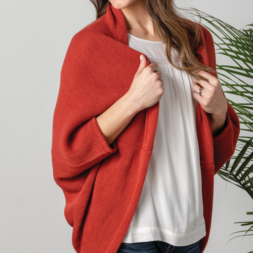 red cardigan on mannequin