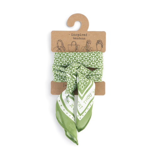 green bandana with white detailing tied around product label card