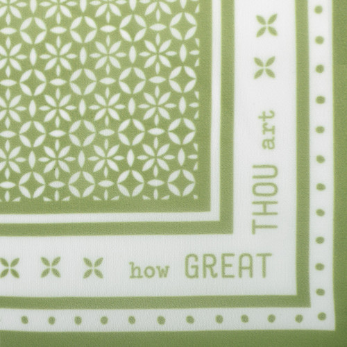 corner of green bandana with white detailing and How Great Thou Art written on corner