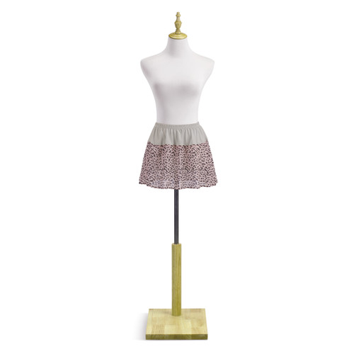 Light pink and black polka dot skirt extender on mannequin