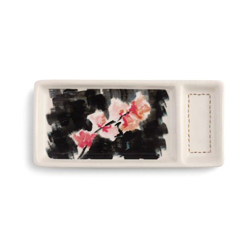 rectangular plate with two sections, one large and one small, with black and pink flowered watercolored design