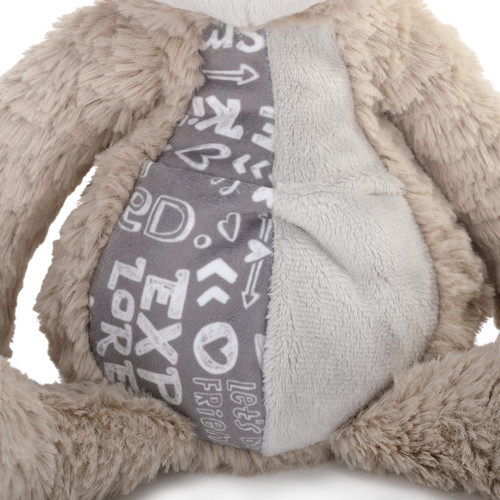 detail shot of stomach of stuffed animal showing patterned fabric on stomach