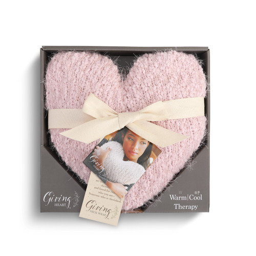 pink knit heart shaped pillow with white ribbon wrapped around it inside gray cardboard box