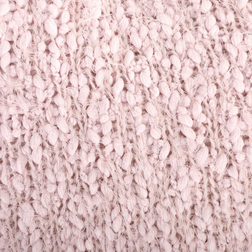 detail shot of pink chunky yarn loosely knit