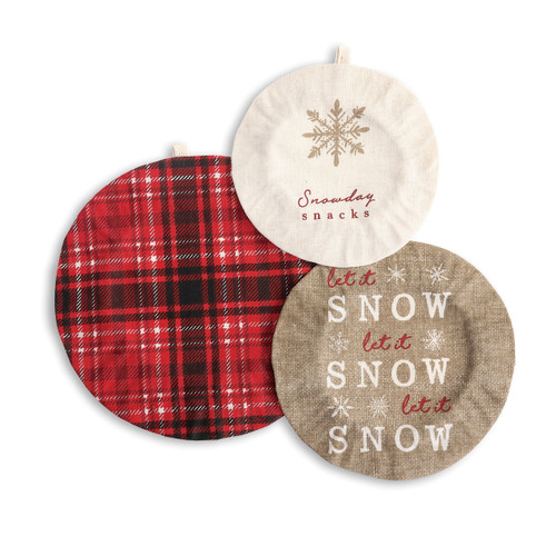 three elastic bowl covers, one red and black plaid, one with snowflake ilustration reading Snowday Snacks, and one tan reading Let it Snow Let it Snow Let it Snow