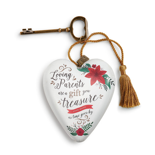 white ceramic heart with quote about loving parents printed on front tied to brass key