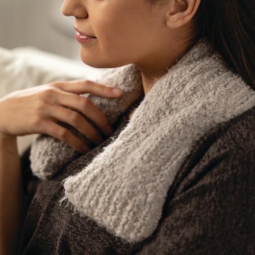 woman wearing gray neck wrap