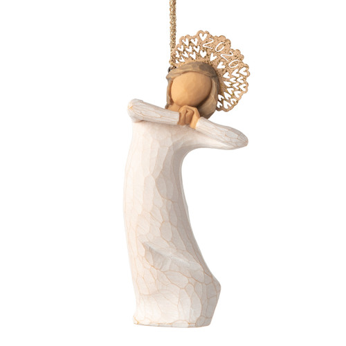 Front view, figure in cream dress, hands clasped under chin, with 2020 cut into gold metal headpiece. Hook, loop affixed to head