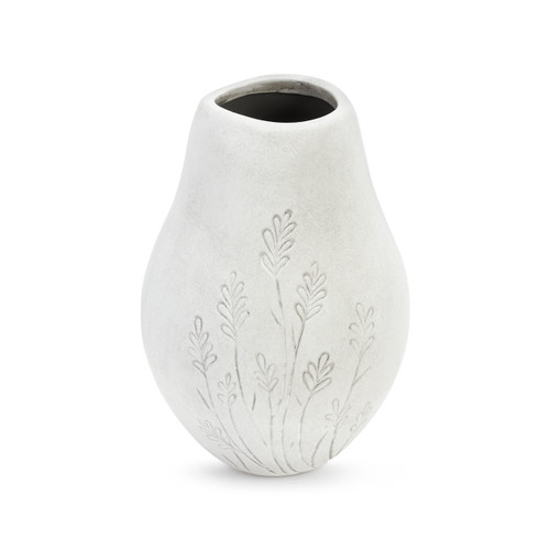 A white asymmetrical vase with flowers engraved.