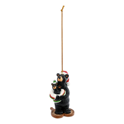 Hanging ornament of a black bear in snowshoes holding a baby bear