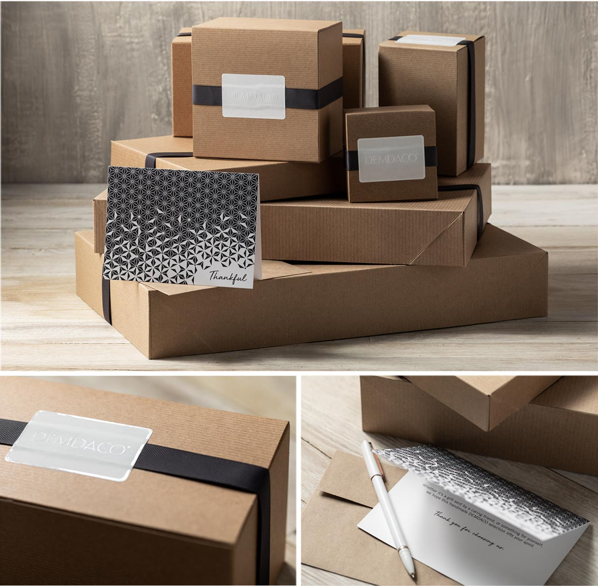 Brown boxes elegantly wrapped in dark ribbon and white DEMDACO sticker. Blue patterned notecard with the word Thankful printed on the front.