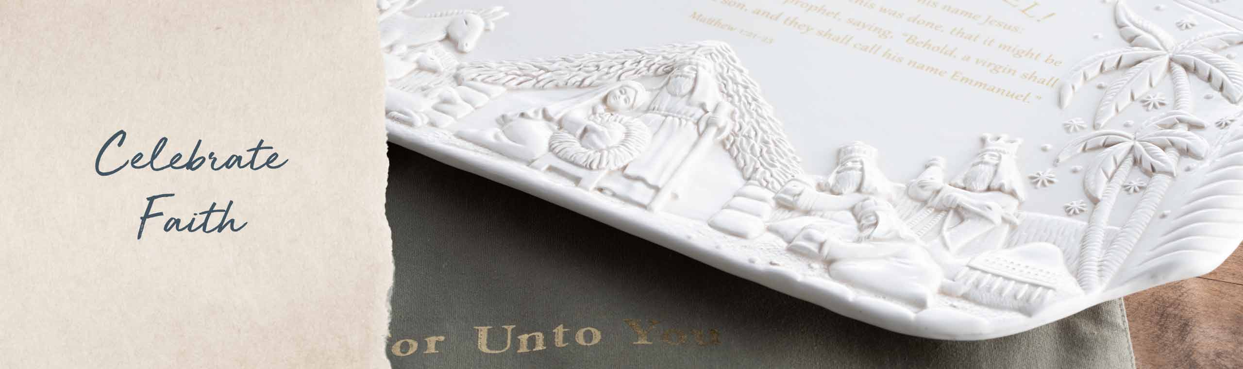 Celebrate Faith. Close up of white ceramic platter depicting Joseph, Mary and Baby Jesus nativity scene.