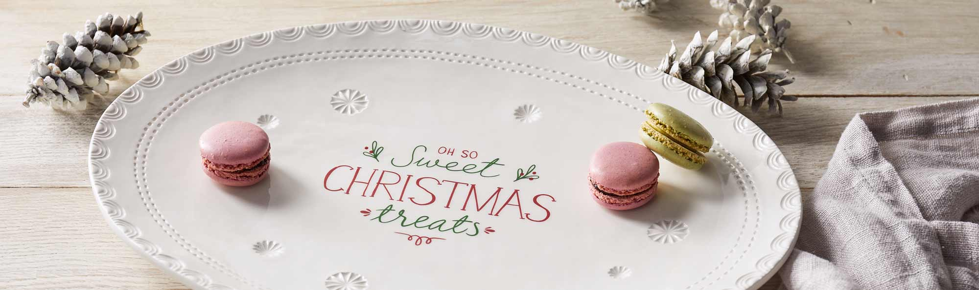 White plate of cookies with the words Oh so Sweet Christmas Treats