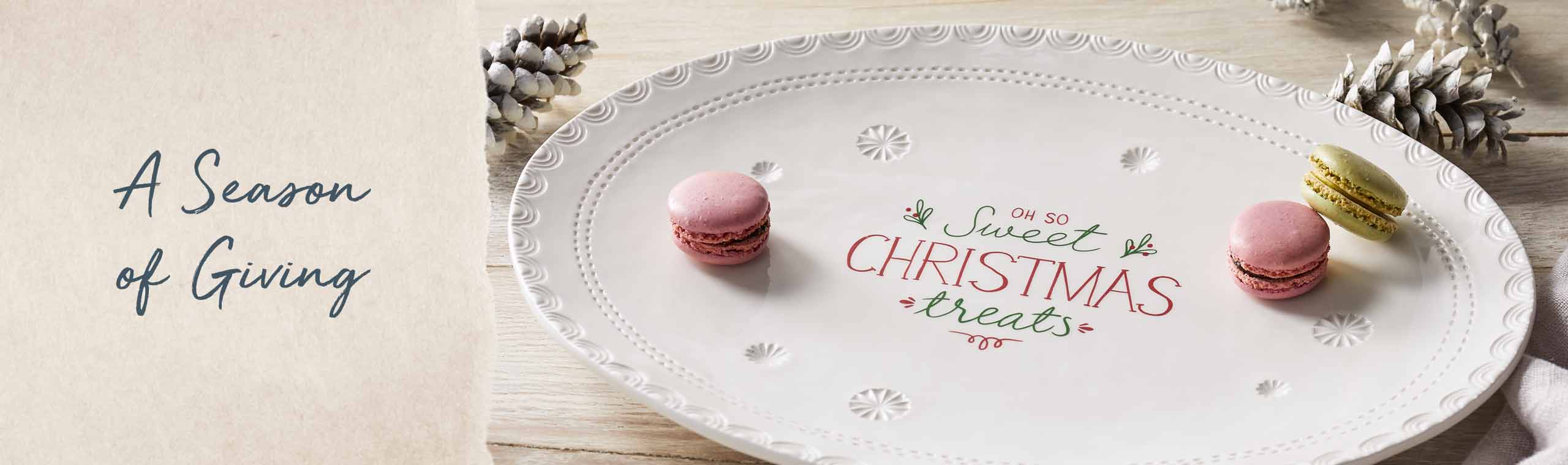 Season of Giving. Cookies on a plate with the message Oh so sweet Christmas treats.