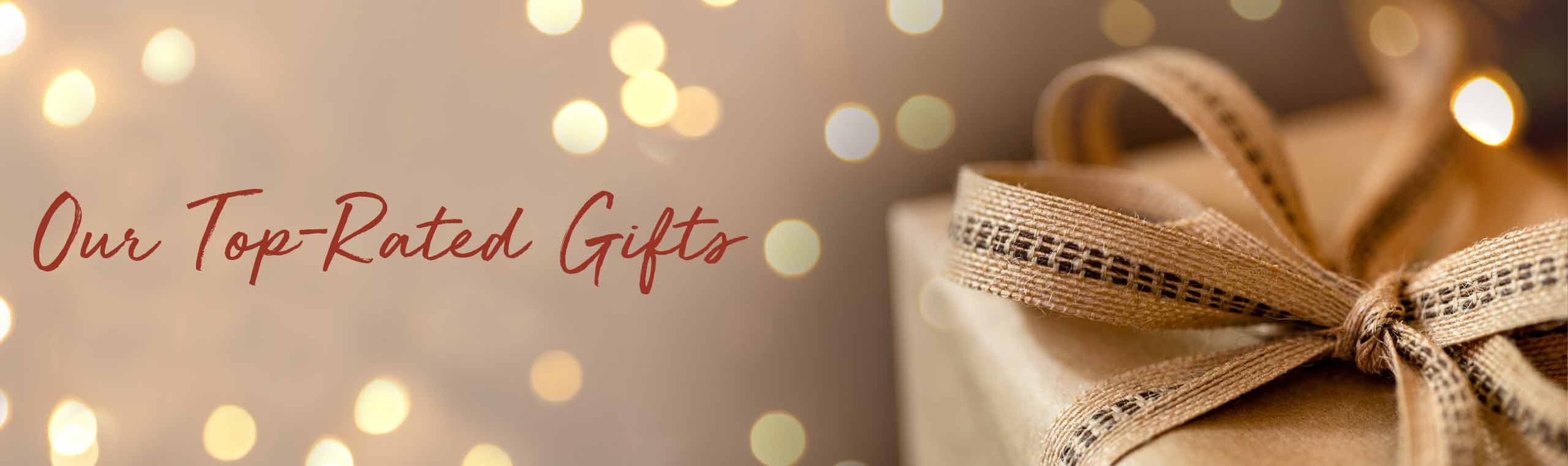 Our Top-Rated Gifts. Brown gift package on a holiday lights background.