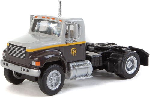 International(R) 4900 Single-Axle Semi Tractor Only - Assembled -- UPS Freight(SM) (gray, gold, brown) - Scale: HO