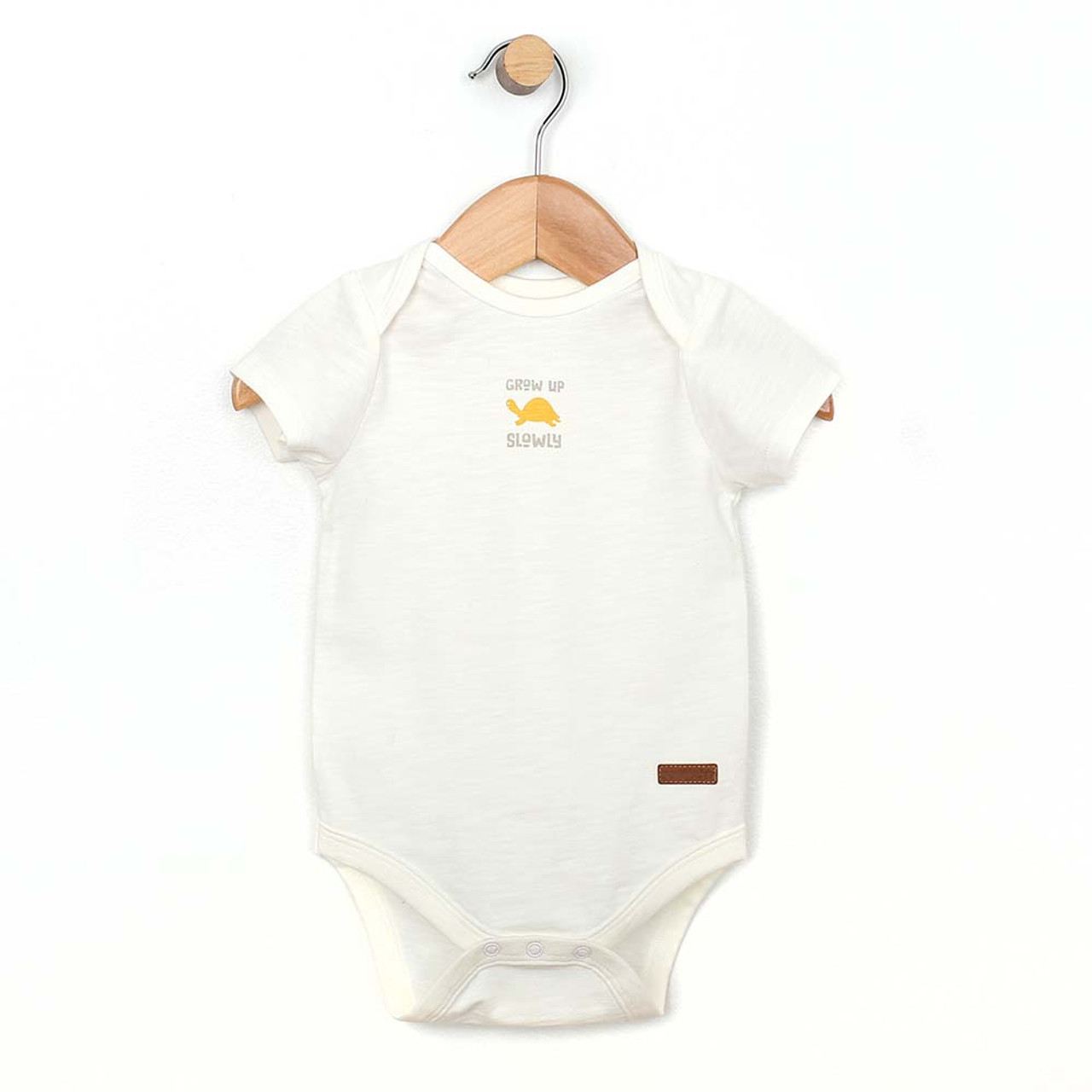 702c8996a Front view of white onesie/body suit/ one piece for boy and girl babies