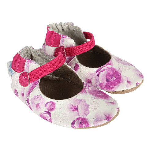 Disney Princesses and flowers decorate this white leather girls' baby shoes.