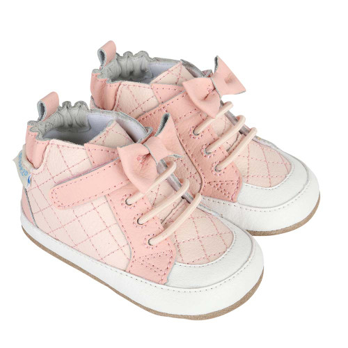 Pink leather girls' baby shoes that look like athletic high top sneakers.  Quilted with bows.
