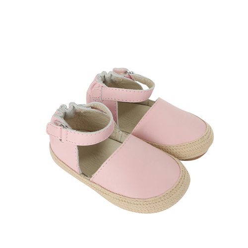 Side view of Kelly Espadrille Baby Shoe, a girl's crib shoe in pink leather with a soft sole.