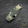 The digital camouflage pattern handle scales are textured with black coated hardware.