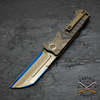 Heretic knives custom Butcher with bronze anodized handles and carbon fiber inlay