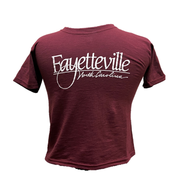 "Maroon child sized short sleeve T-Shirt featuring ""Fayetteville, North Carolina""."