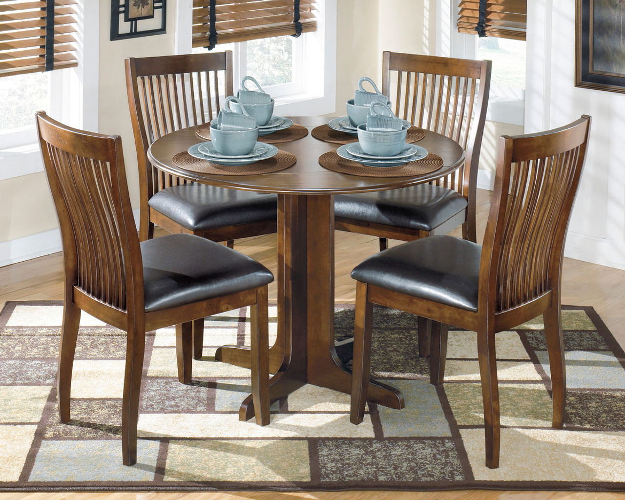The Stuman Medium Brown 5 Pc Round Drop Leaf Dining Set Available At 5 Star Furniture Serving Houston Tx And Surrounding Areas
